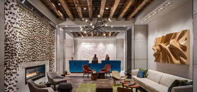 Living room and reception desk at the Kimpton Aertson Hotel in Nashville, TN
